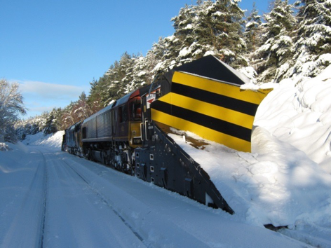 Train ploughing through thick snow