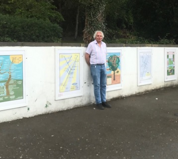 "The artist, Maxwell Roberts next to the ""Four Seasons on the Essex Sunshine Coast"" art display."