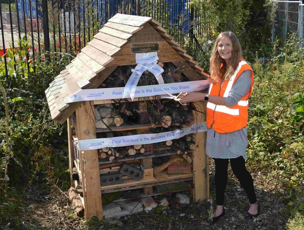 Greater Anglia's Environment and Energy Manager, Stephanie Evans, cuts the ribbon on the insect hotel