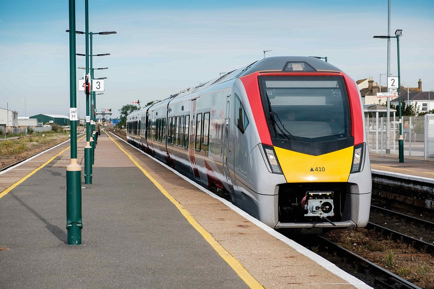 greateranglia new bi-mode train waiting at a station
