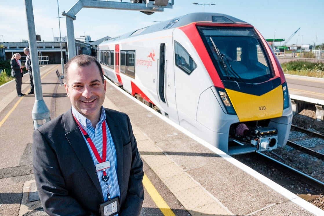Jamie Burles standing next to Greater Anglia train