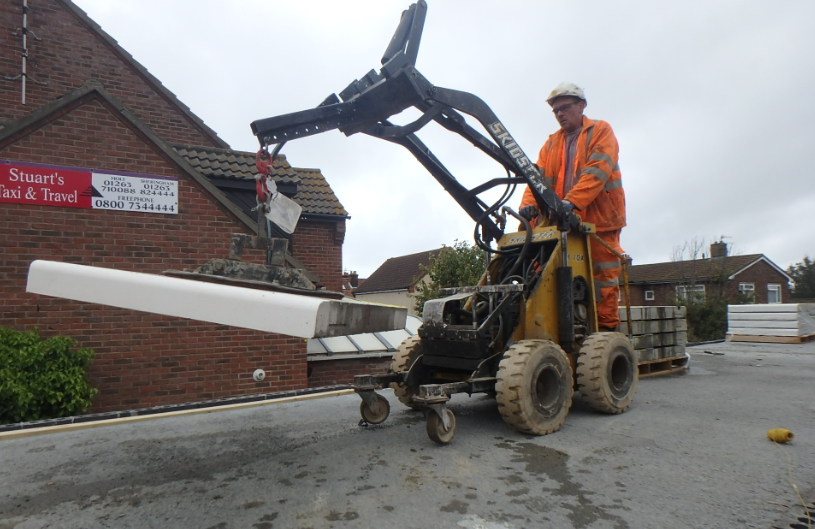 Coping stones being installed at Sheringham station