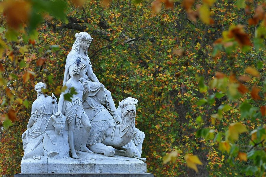 A corner of the Albert Memorial, in London's Hyde Park against a backdrop of autumnal colour