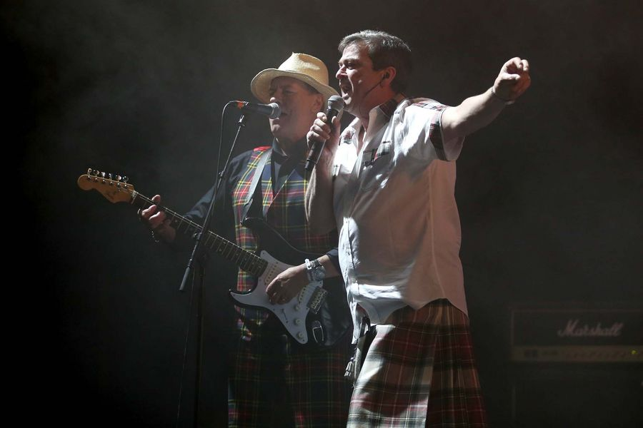 Alan Longmuir and Les McKeown of the Bay City Rollers performing on stage in the King Tut's Wah Wah Tent during the second day of T in the Park, the annual music festival held at Strathallan Castle, Perthshire