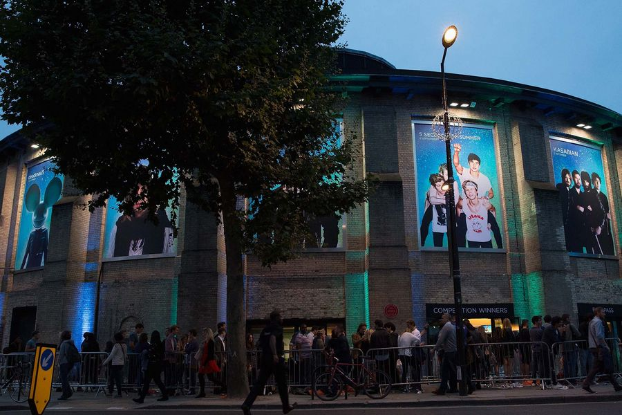Fans outside the Roundhouse in London before Kasabian perform at the iTunes Festival
