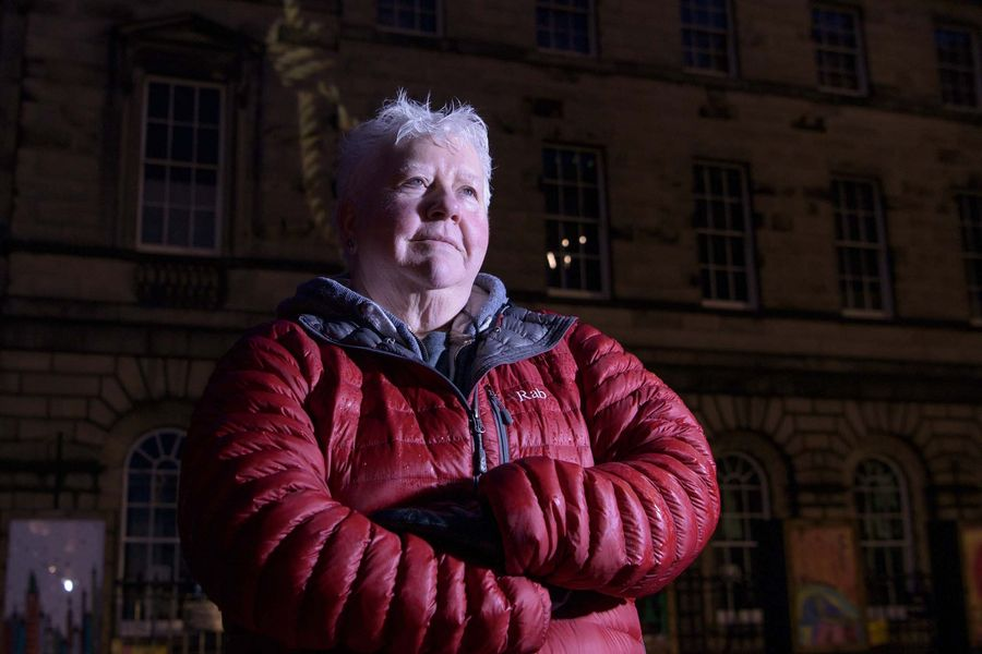 Scottish Crime Writer Val McDermid in front of Edinburgh's Parliament Square