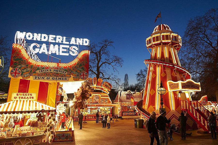 A night-time scene at Winter Wonderland in Hyde Park