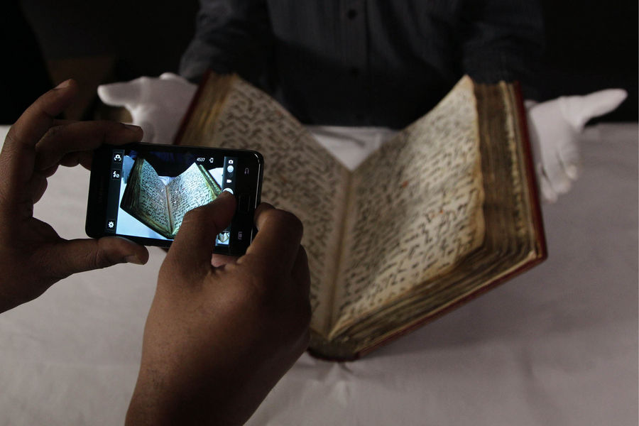David Jacobs, senior conservator of the British Library, during a photocall for the installation of one of the oldest known copies of the Koran