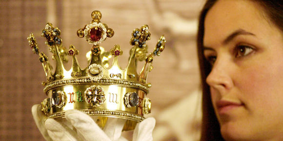 Assistant Curator at the Tower of London, Anna Keay, from the West Highlands of Scotland, holds the 15th century crown of Margaret of York, inside the Tower of London