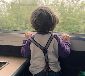 A child looking out of the train window