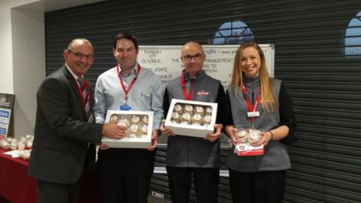 Staff giving out cupcakes at Ipswich station