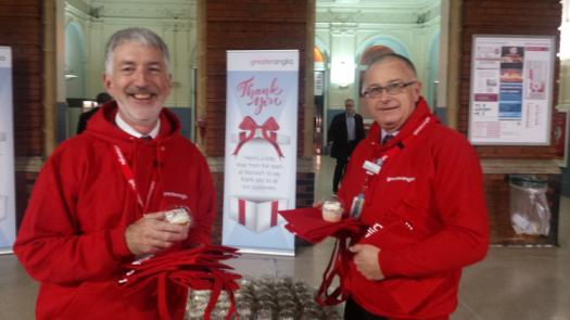 Staff giving out cupcakes at Norwich station