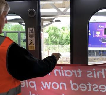 Andy Nelson testing a door safety feature on Greater Anglia's Bombadier train