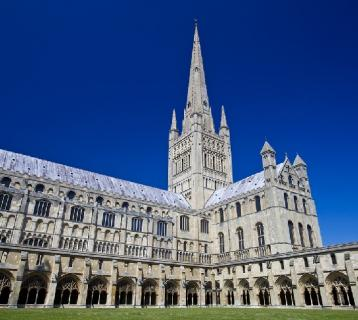 Norwich cathedral under a clear blue sky
