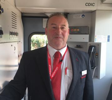Greater Anglia staff member on a train