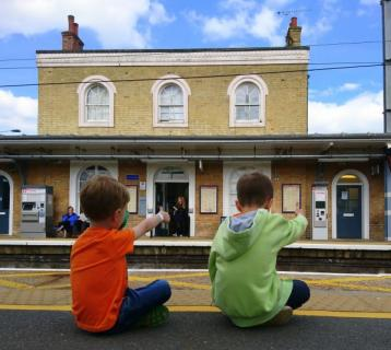 Two kids at the train station