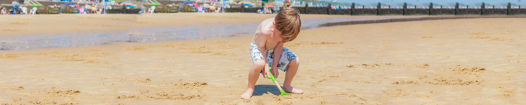 A boy digging in the sand