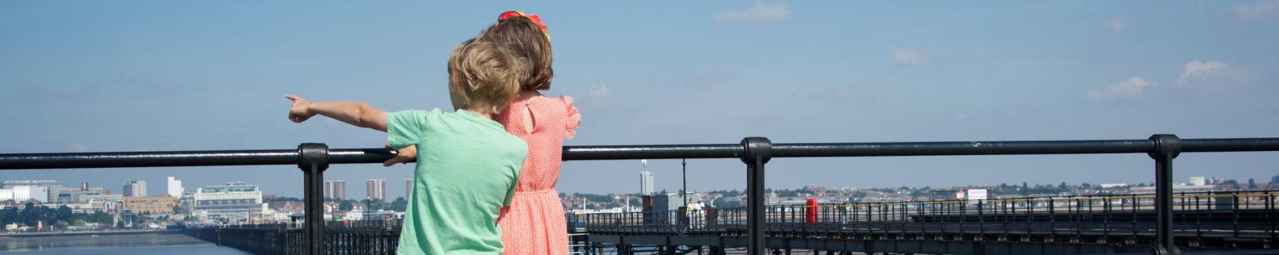 Children looking out from Southend pier