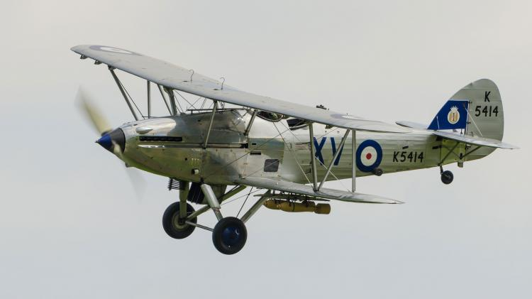 A plane flies at one of Duxford's aerial festivals throughout the year
