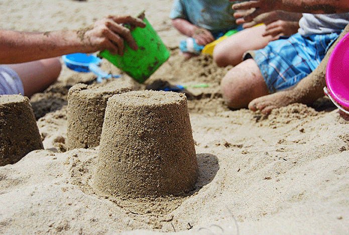 Building a sandcastle at Frinton-on-Sea