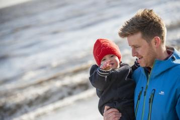 A man and his child on a beach